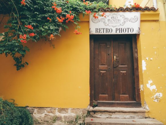 Yellow wall with a retro door, great for retro photos - Plovdiv Tour
